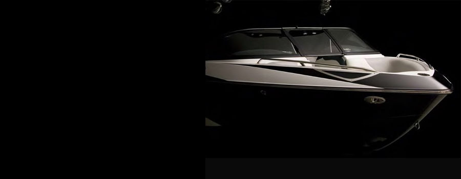 Recreational motor boat with recessed docking light
