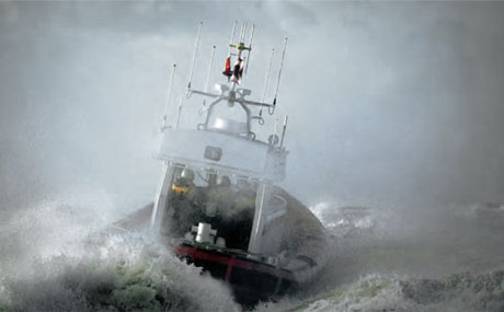 A motor launch in rough seas